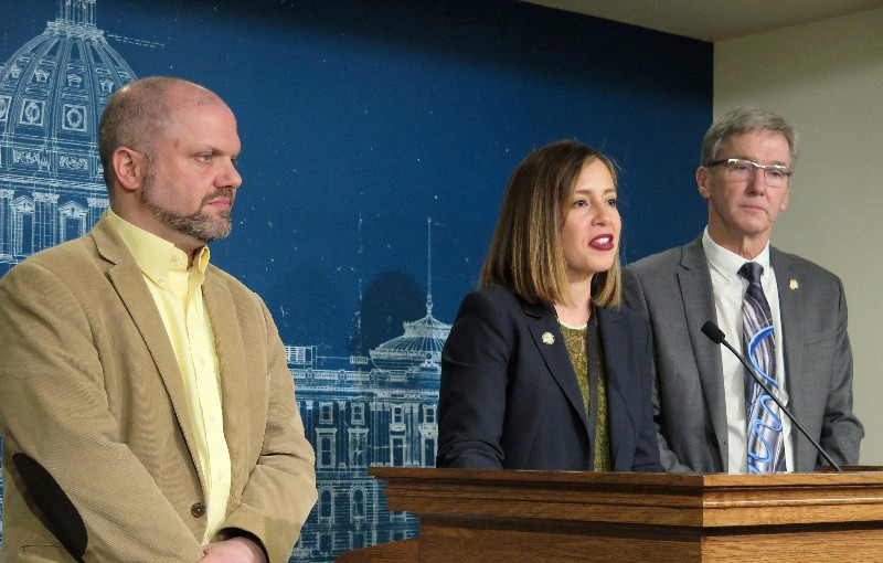 Rep. Mike Freiberg, left, Sen. Melisa Franzen and Sen. Scott Jensen discuss legislation to legalize and regulate recreational marijuana use at a news conference inside the Minnesota State Capitol in St. Paul on Monday, Jan. 28, 2019. (Tim Pugmire/Minnesota Public Radio via AP)