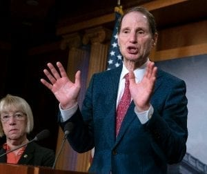 In this Dec. 19, 2018, file photo, Sen. Ron Wyden, D-Ore., joined at left by Sen. Patty Murray, D-Ore., speaks during a news conference to press Congress to intervene on behalf of the Affordable Care Act, after a federal judge in Texas ruled it unconstitutional, on Capitol Hill in Washington. Wyden has proposed legislation that would give states a free hand to allow legal marijuana markets without the threat of federal criminal intervention. (AP Photo/J. Scott Applewhite, File)