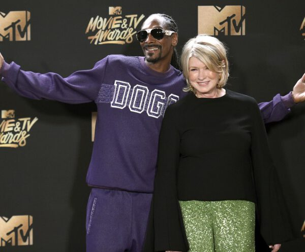 """In this May 7, 2017 file photo, Snoop Dogg, left, and Martha Stewart pose in the press room at the MTV Movie and TV Awards in Los Angeles. The domestic diva who brought us hemp yarn is now partnering with Canada's Canopy Growth Corp. to develop new products containing CBD, a compound derived from hemp and marijuana that doesn't cause a high. Stewart's tie-up with Canopy may not be a surprise to her fans. In 2015, she baked brownies on """"The Martha Stewart Show"""" with marijuana aficionado Snoop Dogg, and hinted that Snoop could add a little weed if he wanted to. (Photo by Richard Shotwell/Invision/AP, File)"""