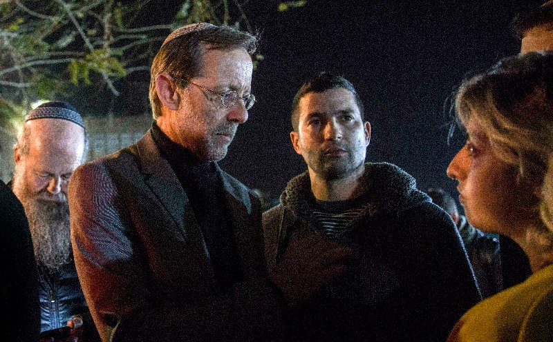 In this Thursday, March 14, 2019 photo, Zehut party leader Moshe Feiglin, second left, attends an election campaign event in Sderot, Israel. The Cinderella story of Israel's current election campaign is a fringe party led by Feiglin, an ultranationalist libertarian with a criminal record, who vows to legalize marijuana in an improbable run to parliament. Feiglin's Zehut party has a real shot of getting elected and could even emerge as a kingmaker in a tightly contested race for prime minister. (AP Photo/Tsafrir Abayov)