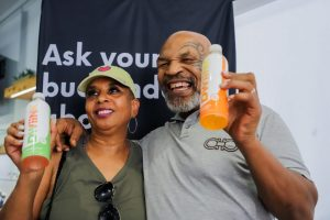Mike Tyson and Fan with DWiiNK Beverage at The+Source